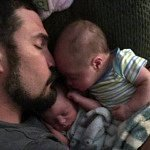 father with infant twin boys