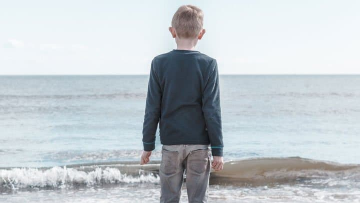 Boy looking at sea