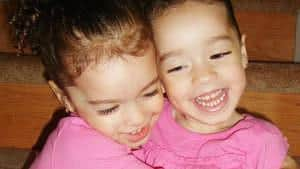 Twin girls hugging