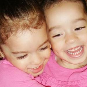 Twin girls hugging