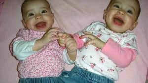 Twin girls laughing