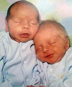 twins sleeping and smiling