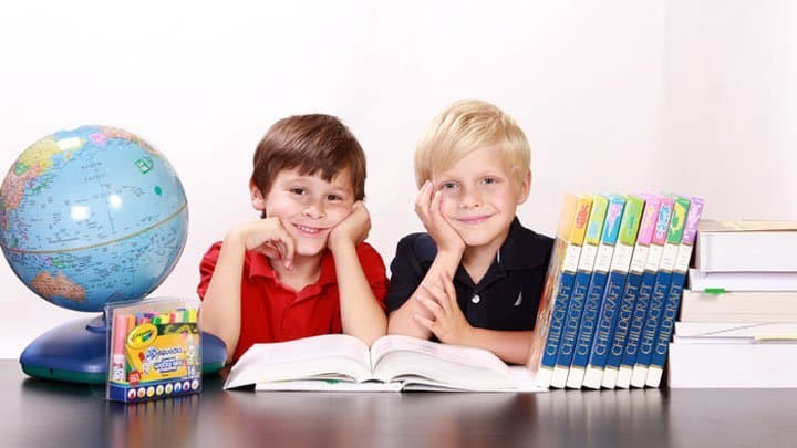 twins in school reading books