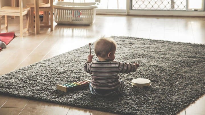 Baby playing instrument
