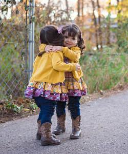 Identical twin girls hugging