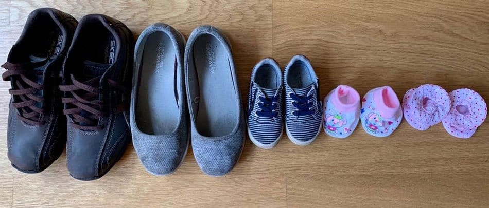 Lineup of shoes for twin pregnancy announcement
