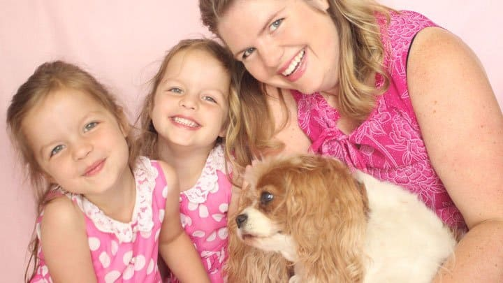 Dog Zoe with Tracy Murdock and identical twin daughters